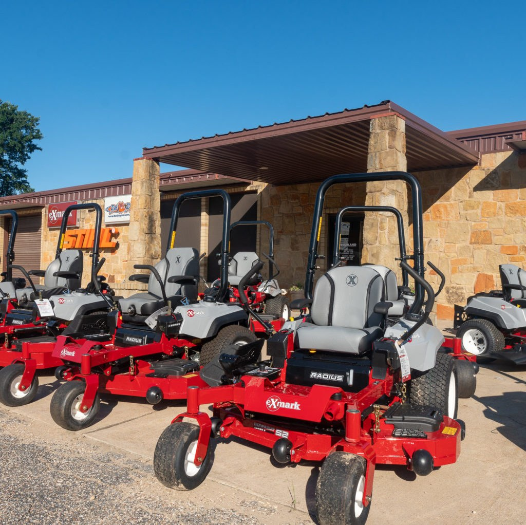 Exmark riding mowers in front of Bourland Landscape Supplies & Outdoor Power Equipment